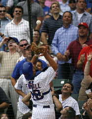 Chicago Cubs player Jason Kendall tries to catch a foul ball hit by St. Louis Cardinals Rick Ankiel during the fourth inning of their MLB National League baseball game in Chicago