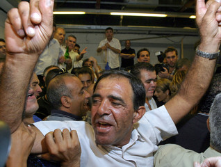 Likud party members celebrate after the vote at the Likud party convention in Tel Aviv