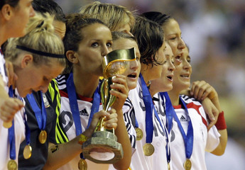 Germany's Fatmire Bajramaj kisses the trophy after their victory over Brazil in the final of the 2007 FIFA Women's World Cup soccer tournament in Shanghai