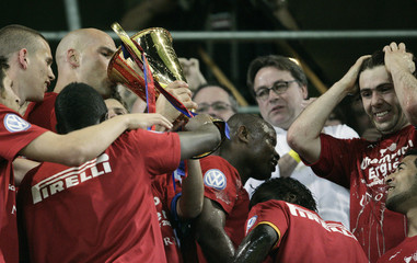 FCB's players celebrate with the trophy after winning the Swiss Super League soccer championship in Basel