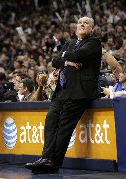 Denver Nuggets head coach George  Karl looks at the scoreboard in their NBA basketball game in Dallas