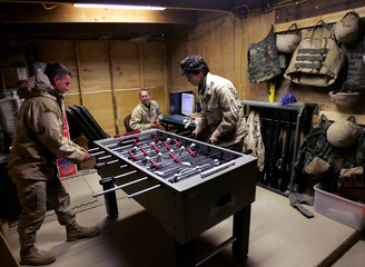 US army personnel Planche plays foosball with Colonel Poore during Christmas eve at Bagram airbase north of Kabul