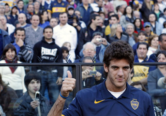 Newly crowned US Open champion Del Potro of Argentina gives a thumbs-up as he visits La Bombonera stadium before the Argentine First Division match between Boca Juniors and Godoy Cruz in Buenos Aires
