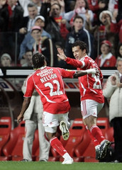 Benfica's Sabrosa celebrates goal against Pacos Ferreira with team mate Nelson during their Portuguese Premier League match in Lisbon