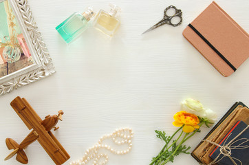 top view of women accessories, over wooden table
