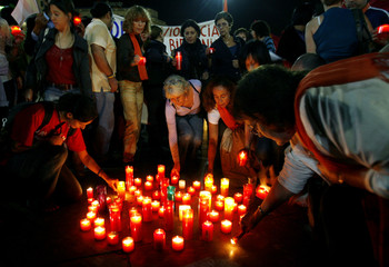 People light candles against repression in Myanmar in central Barcelona