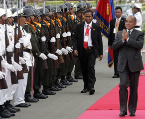 Cambodia's King Norodom Sihamoni walks past honor guard in Phnom Penh