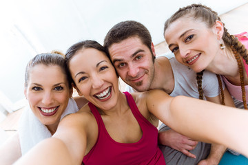 Group of people taking a selfie after yoga session.
