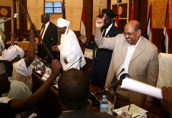Sudan's President Omar Hassan al-Bashir greets participants of a national initiative to bring peace to Darfur, in Khartoum