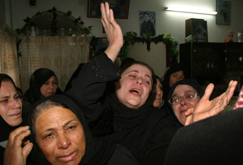 Relatives of a Palestinian militant Mohammed al-Jertle mourn during his funeral at Khan younis camp.