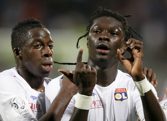 """Olympique Lyon's Gomis gestures """"O.L."""" after scoring against AS Nancy during their French Ligue 1 soccer match in Lyon"""