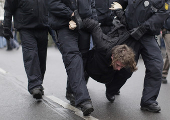 German police remove protestor during a Neo-Nazi demonstration in Berlin