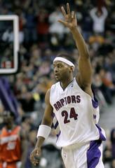 Raptors Peterson celebrates a basket.