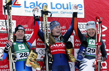 Winners of the Women's World Cup Downhill celebrate on the podium in Lake Louise, Alberta December 3..