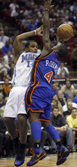 Magic guard Nelson passes the ball around Knicks guard Robinson during second-half NBA basketball action in Orlando