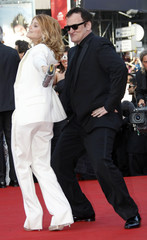 """Director Quentin Tarantino dances with actress Melanie Laurent as they arrive on the red carpet for the screening of the film """"Inglourious Basterds"""" at the 62nd Cannes Film Festival"""