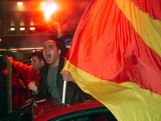 Turkish soccer fans wave their team's flags in central Istanbul as they celebrate Turkish champions ..