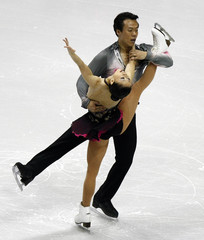 Shen and Zhao of China perform during the Pairs Short Program at Skate America in Lake Placid, NY
