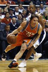 Phoenix Suns guard Steve Nash drives around Orlando Magic guard Rafer Alston during their NBA basketball game in Orlando