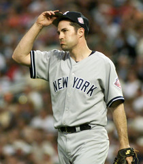 YANKEES MIKE MUSSINA AFTER TWO ORIOLES REACH BASE SAFELY.