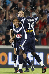 Bordeaux's Tremoulinas, Jurietti and Diawara celebrate after their second goal during French Ligue 1 soccer match in Bordeaux