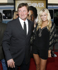"""Former NHL hockey player and current coach Wayne Gretzky poses with his daughter Paulina Gretzky at the Los Angeles premiere of the film """"The Hangover"""" at the Grauman's Chinese theatre in Hollywood"""