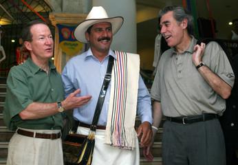 U.S. Secretary of Commerce Gutierrez, U.S. ambassador to Colombia Brownfield and Colombia's coffee icon Juan Valdez joke in Cartagena