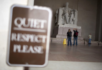 Visitors take pictures of the statue of Abraham Lincoln at the Lincoln Memorial ahead of celebrations commemorating the 200th anniversary of Lincoln's birth in Washington