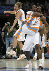 University of Tennessee Lady Volunteers' players celebrate their team's victory in Cleveland