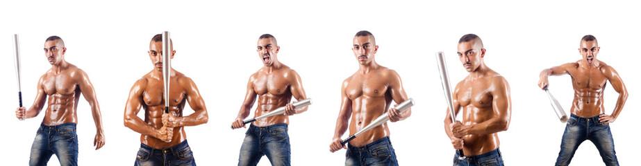 Muscular man with baseball bat on white
