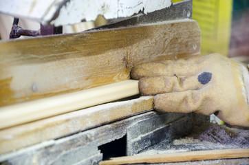 Apprentice Using Circular Saw In Carpentry Workshop