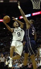 SPURS TONY PARKER GOES HIGH TO SHOOT AGAINST NETS JASON COLLINS.