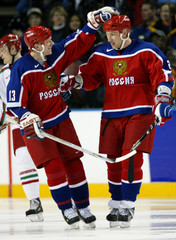 MIRONOV CONGRATULATED ON GOAL OVER BELARUS OLYMPIC MENS ICE HOCKEY.