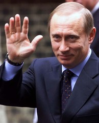 RUSSIAN PREMIER PUTIN WAVES AS HE ARRIVES AT DOWNING STREET IN LONDON.