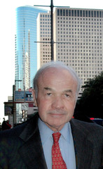 Enron founder Ken Lay with the blue-green former Enron tower in the background leaves the federal courthouse for lunch recess in Houston, Texas, February 7