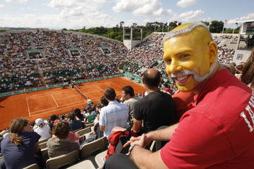Belgium's tennis fan Khalil, with his face painted as a tennis ball, attends a match during the French Open tennis tournament in Paris