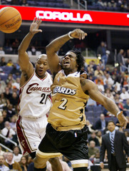 Snow of the Cleveland Cavaliers slaps the ball from Stevenson of the Washington Wizards during the first quarter of their NBA game in Washington