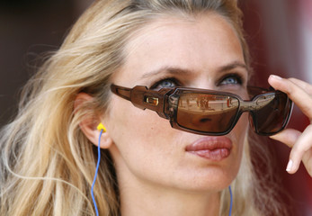 Model Canadas puts on her sun glasses during a free practice session for the Spanish Grand Prix at the Circuit de Catalunya in Montmelo,
