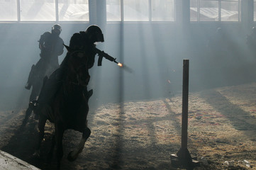Riot policemen on horsebacks shoot at a target during a presentation to foreign diplomats in Moscow