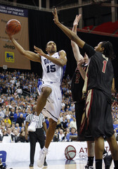 Duke guard Gerald Henderson drives to the basket against Florida State defenders at ACC Championship in Atlanta