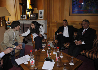 Relatives of kidnapped French-Colombian politician Ingrid Betancourt attend a meeting with Ecuador's President Rafael Correa in Paris