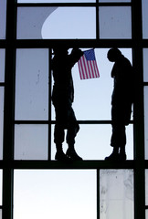 MARINES HANG A U.S. FLAG AT KANDAHAR AIRPORT.