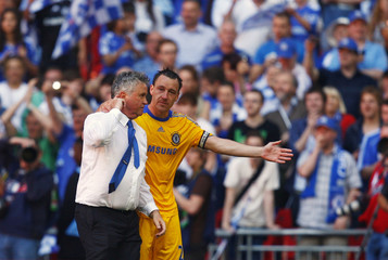 Chelsea's Terry embraces manager Hiddink after their English FA Cup final soccer match victory against Everton in London