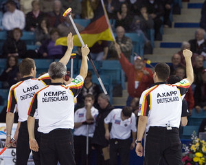 Germany celebrates win over Japan during World Men's Curling in Moncton, New Brunswick