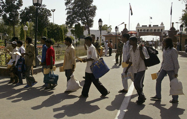 Indian fishermen who were released from Pakistani jails arrive at Wagah