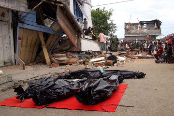 Bodies of earthquake survivors lie on a street in Gunungsitoli on the Indonesian island of Nias.