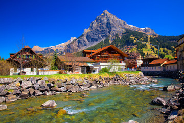Colorful wooden houses with flowers in Kandersteg village, Canton Bern, Switzerland, Europe. Wall mural