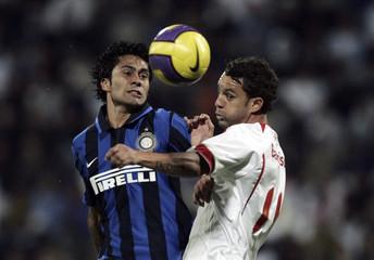 Inter Milan's Jimenez and Rodrigues of Internacional de Porto Alegre battle for the soccer ball during the final of the Mohammad Bin Rashid International Football Championship in Dubai