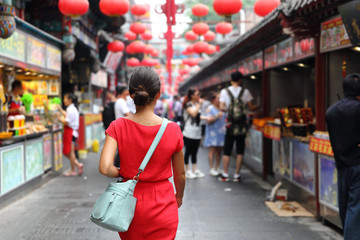 Canvas Prints Asian Famous Place Woman tourist walking in chinatown on china travel. Asian girl on Wangfujing food street during Asia summer vacation. Traditional Beijing snacks being sold at chinese chinatown outdoor market.