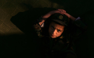 Palestinian youth attends a Hamas rally before an explosion in Jabalya refugee camp, north of the Gaza Strip